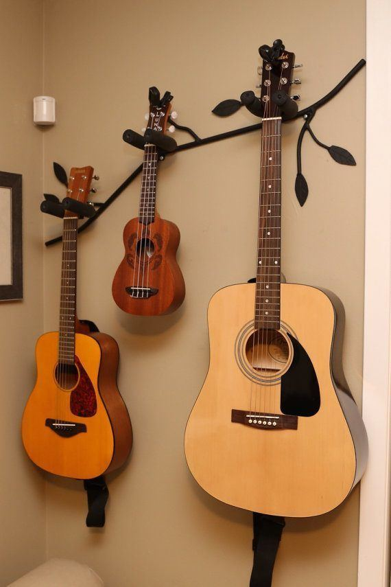 how to hang a guitar on the wall with a diy holder. Black Bedroom Furniture Sets. Home Design Ideas