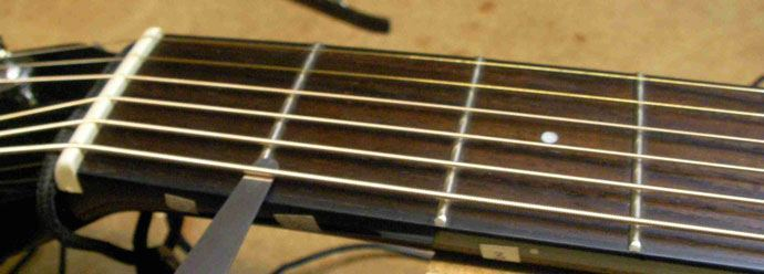 how to lower the action on an acoustic guitar. Black Bedroom Furniture Sets. Home Design Ideas