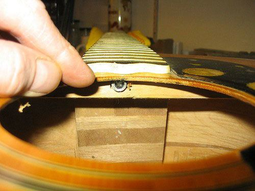 how to adjust guitar neck without truss rod