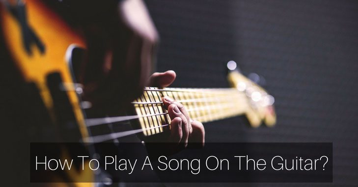 how to play a song on the guitar