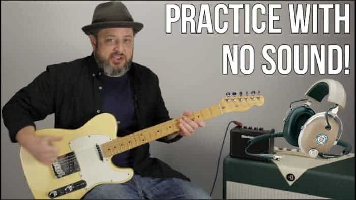How can I practice my electric guitar quietly